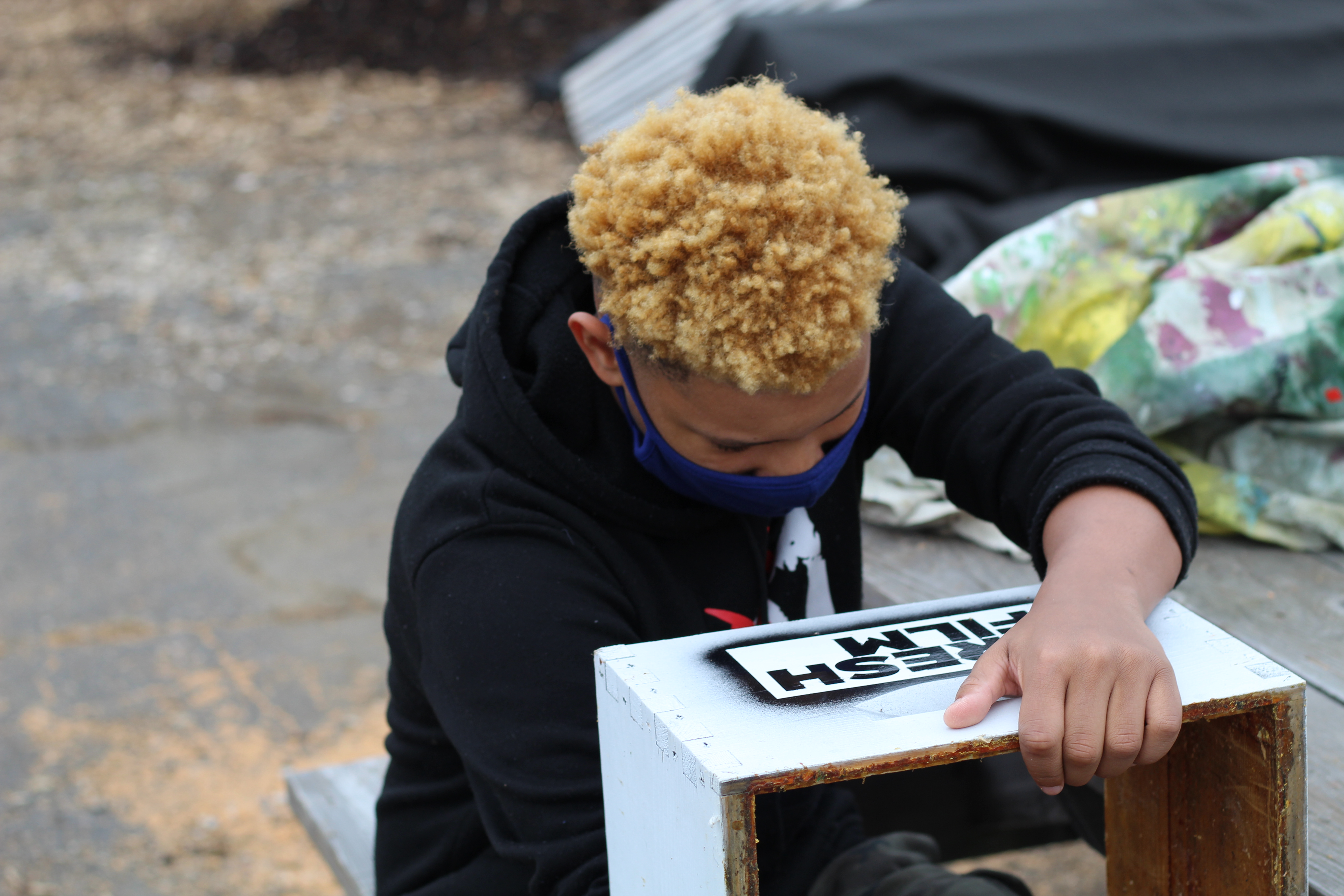Nazir Grayson preparing one of the box for a sponsorship