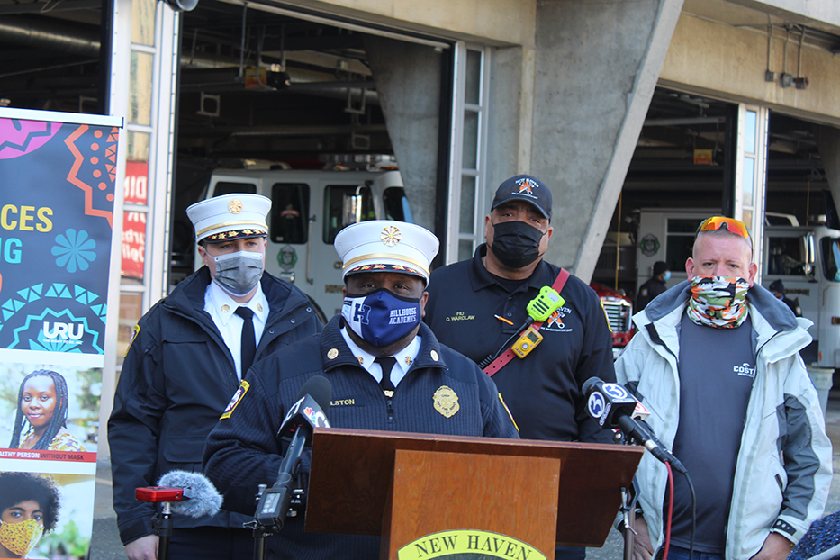 Center: Chief John Alston addresses the crowd emphasizing the importance of firehouse stations in the community.