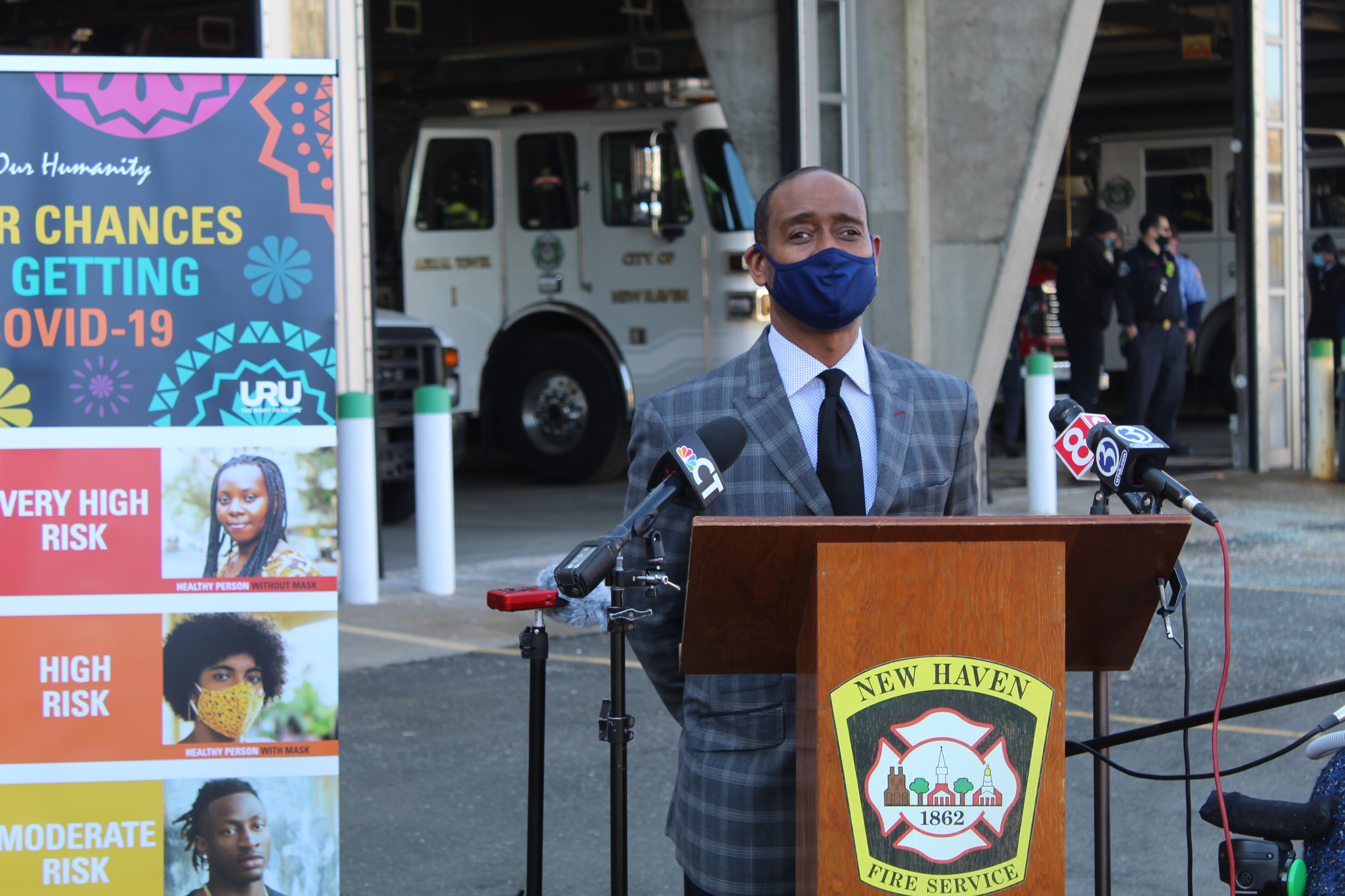 Pastor Darrell Brooks, pastor at Beulah Heights First Pentacostal Church, delivering remarks on the importance of vaccinating Black communities.